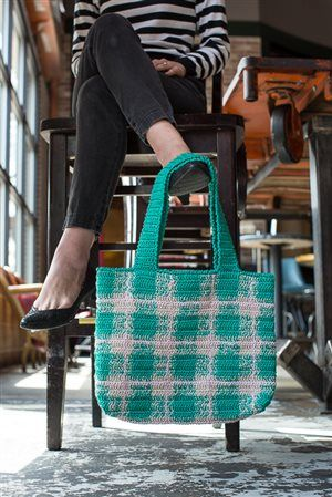 This plaid crochet bag, worked in three colors of the chubbiest threads, is the perfect size for an afternoon at the bowling alley.