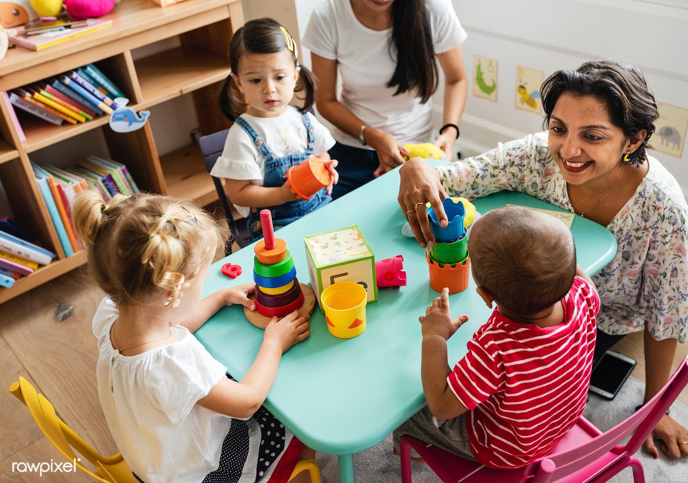 Download Premium Image Of Nursery Children Playing With Teacher In The