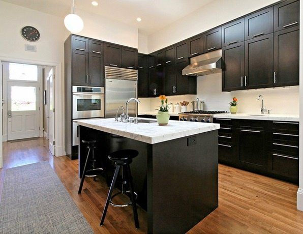 Black Kitchen Design White Countertops Wood Flooring Stainless Steel Appliances Black Bar Stools Kitchen Cabinet Design Black Kitchen Cabinets Kitchen Design