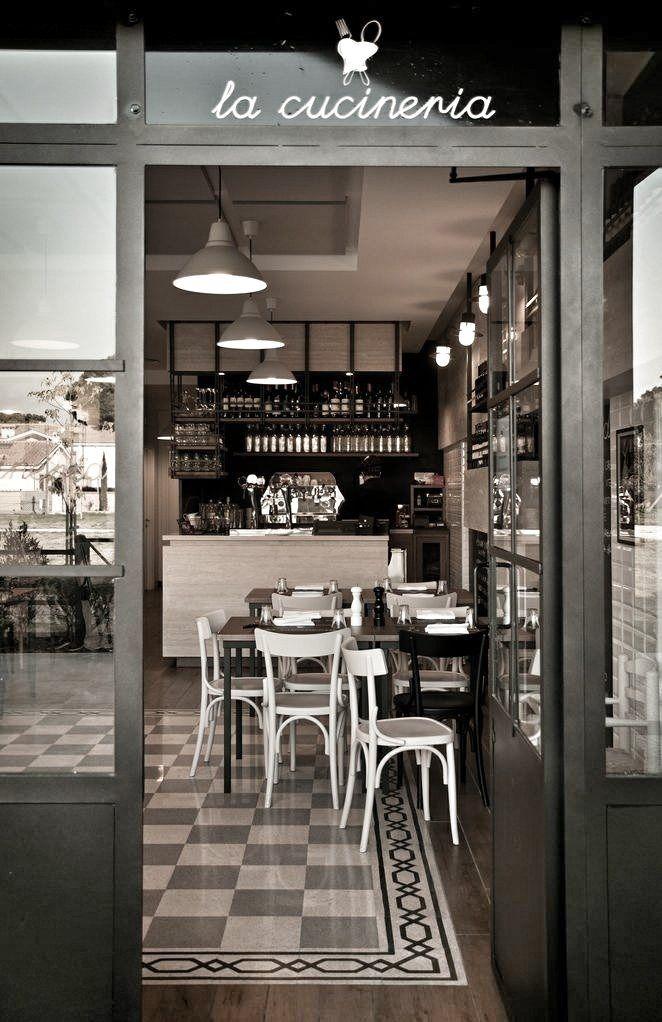 Interior de un restaurante con colores blancos y negros y for Home design roma