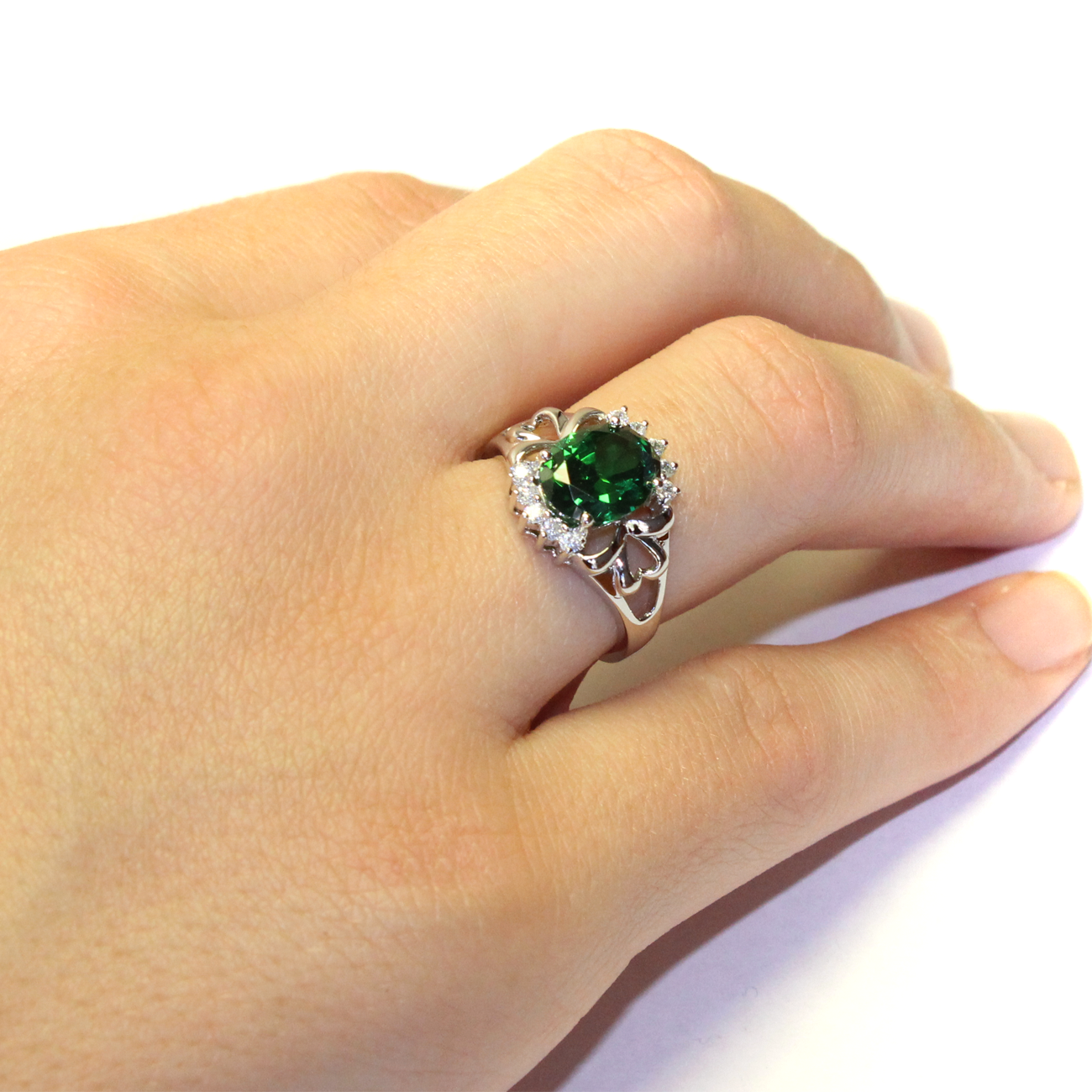 Classic Green Emerald Promise Ring On A Womans Hand