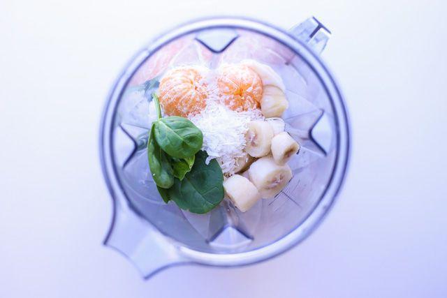 Immune Boosting Green Coconut Orange Smoothie Recipe Beverages with spinach, unsweetened shredded dried coconut, frozen banana, yoghurt, orange, milk