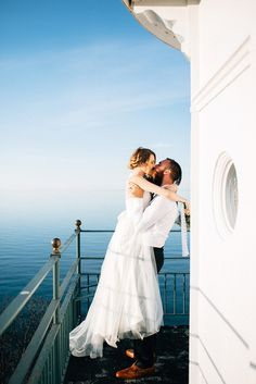 Jess and Destiny's $2,500 magical elopement to an $1800's lighthouse overlooking Lake Superior. See their amazing photos by Jesse David Green on www.intimateweddings.com/blog/real-weddings #budgetweddings #elopements #uniquevenues
