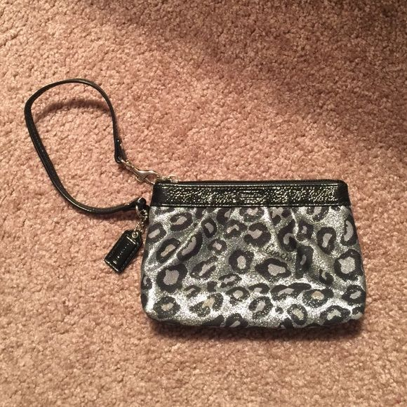 Coach Leopard Print Wristlet This is a gently used Coach Wristlet.  It is super cute to use for a night out.  My iPhone 6plus doesn't fit in there so I must find this little gal a new home! Note: There is a small black mark on the inside (see picture).  Please do not hesitate to contact me with any questions . Coach Bags Clutches & Wristlets