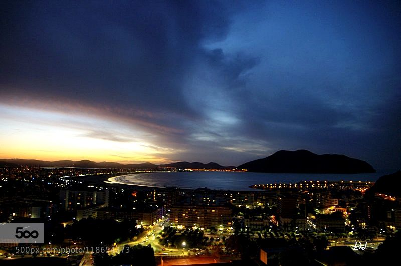 LAREDO ... - Pinned by Mak Khalaf Not really a night photo no tripods even less a long exposure since the heights by going out of the restaurant a panorama at day fall with the lights of the city!! Hope you like !! :0) Landscapes EspañaLaredoPentax k5Spainatlantic oceancitycloudscoasteveninggulflightseasummer by DanielJehanno