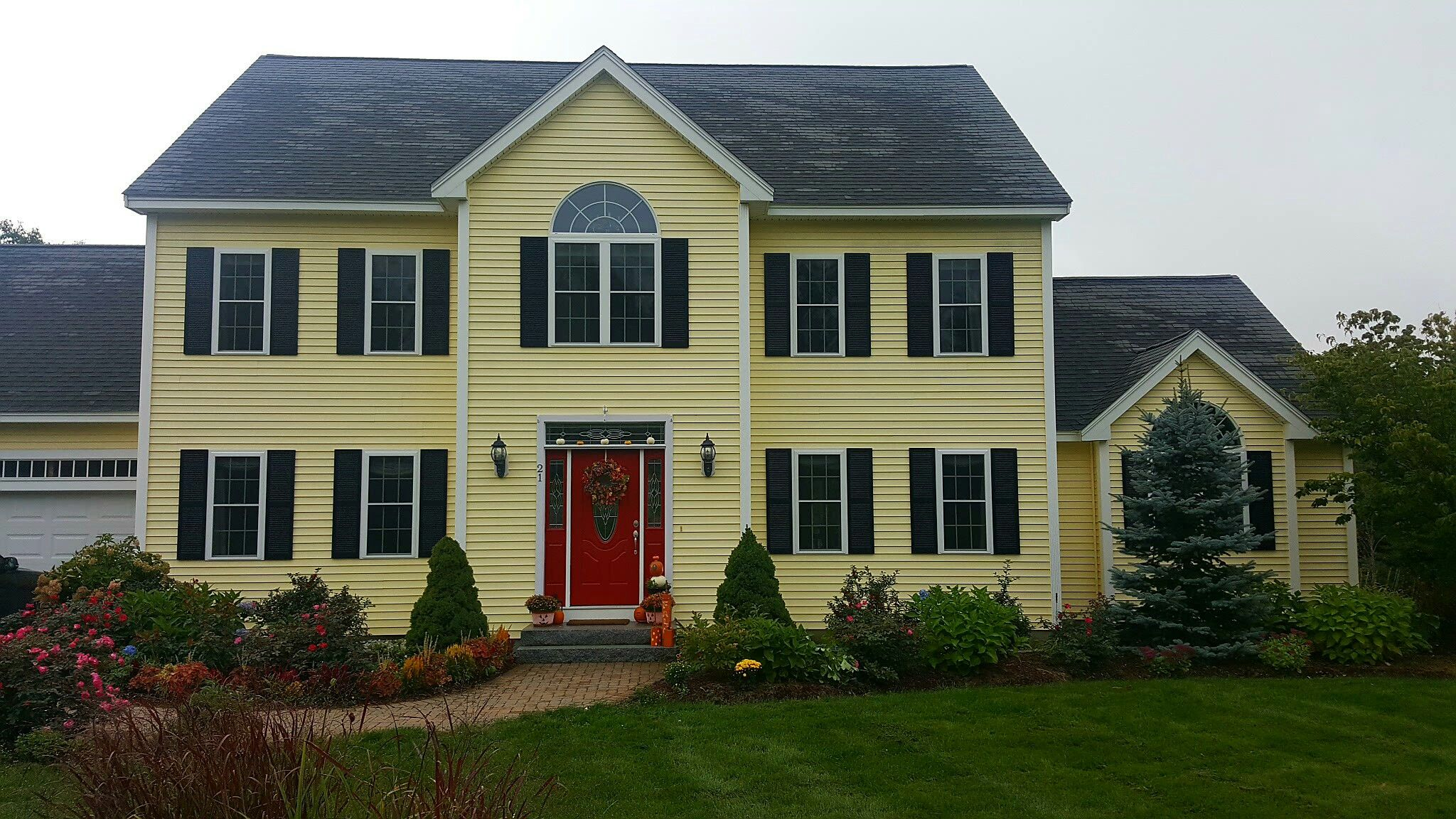 My red dream door done for colonial yellow house black