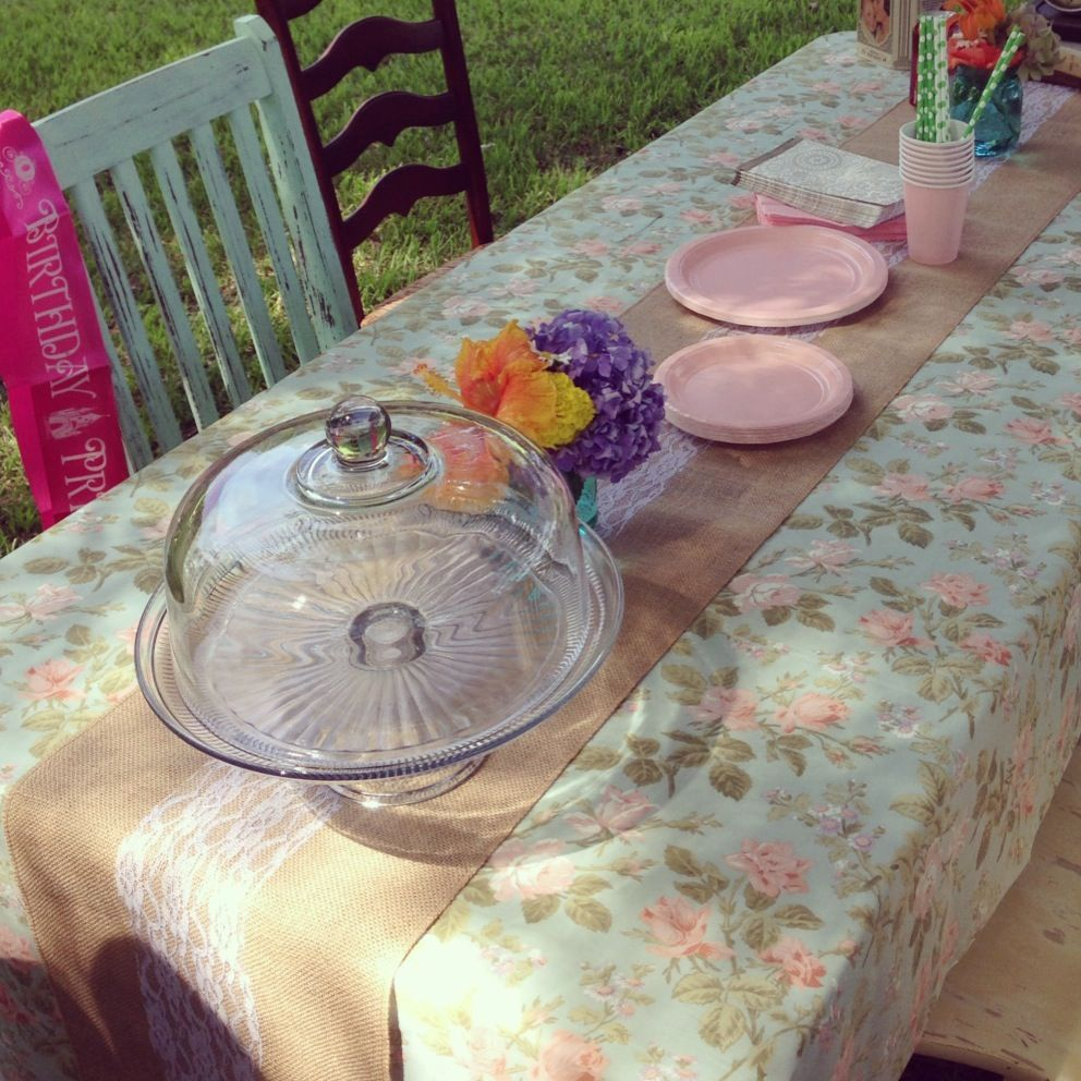 A table setup with our cake stand mason jars linens and