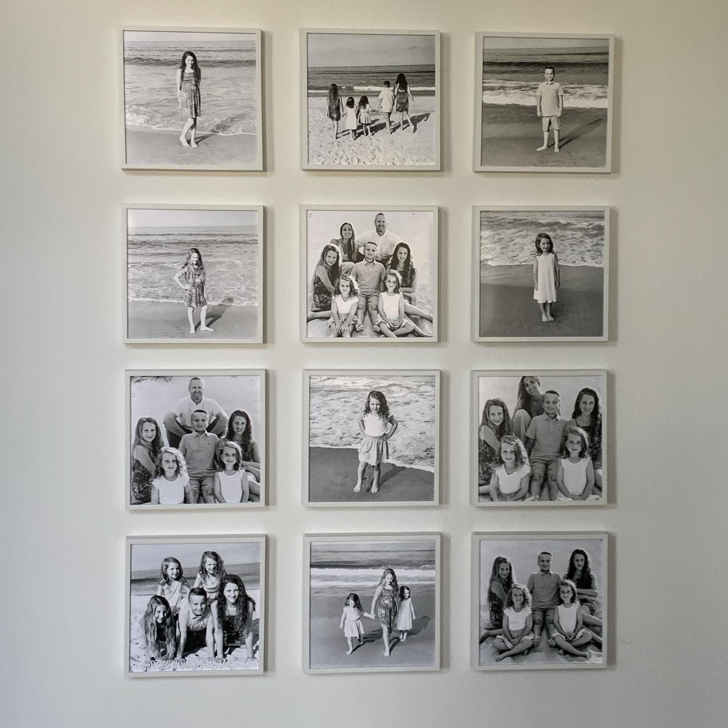 Would you prefer a wall in color or in black and white? Photo via IG:  riggs_interiors in 2020 | Black and white photo wall, Photo wall design,  Photo wall