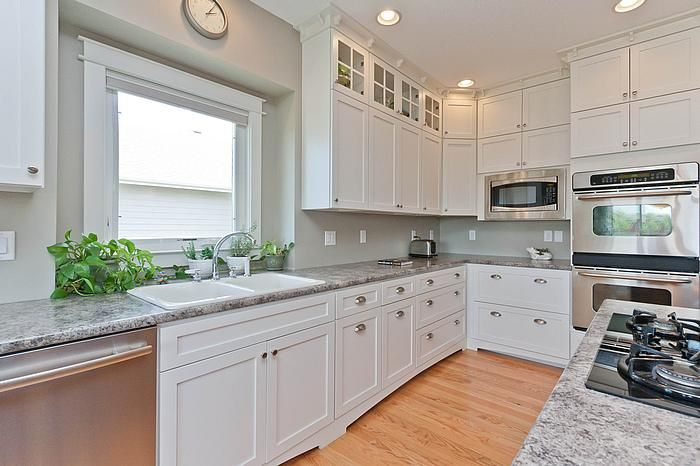 Designer: Sarah (Cabinets) And Johnnie (Flooring) Cabinets (Perimeter):  Dura Supreme Cabinetry Homestead Panel In Classic White Cabinets(Island):  Dura ...