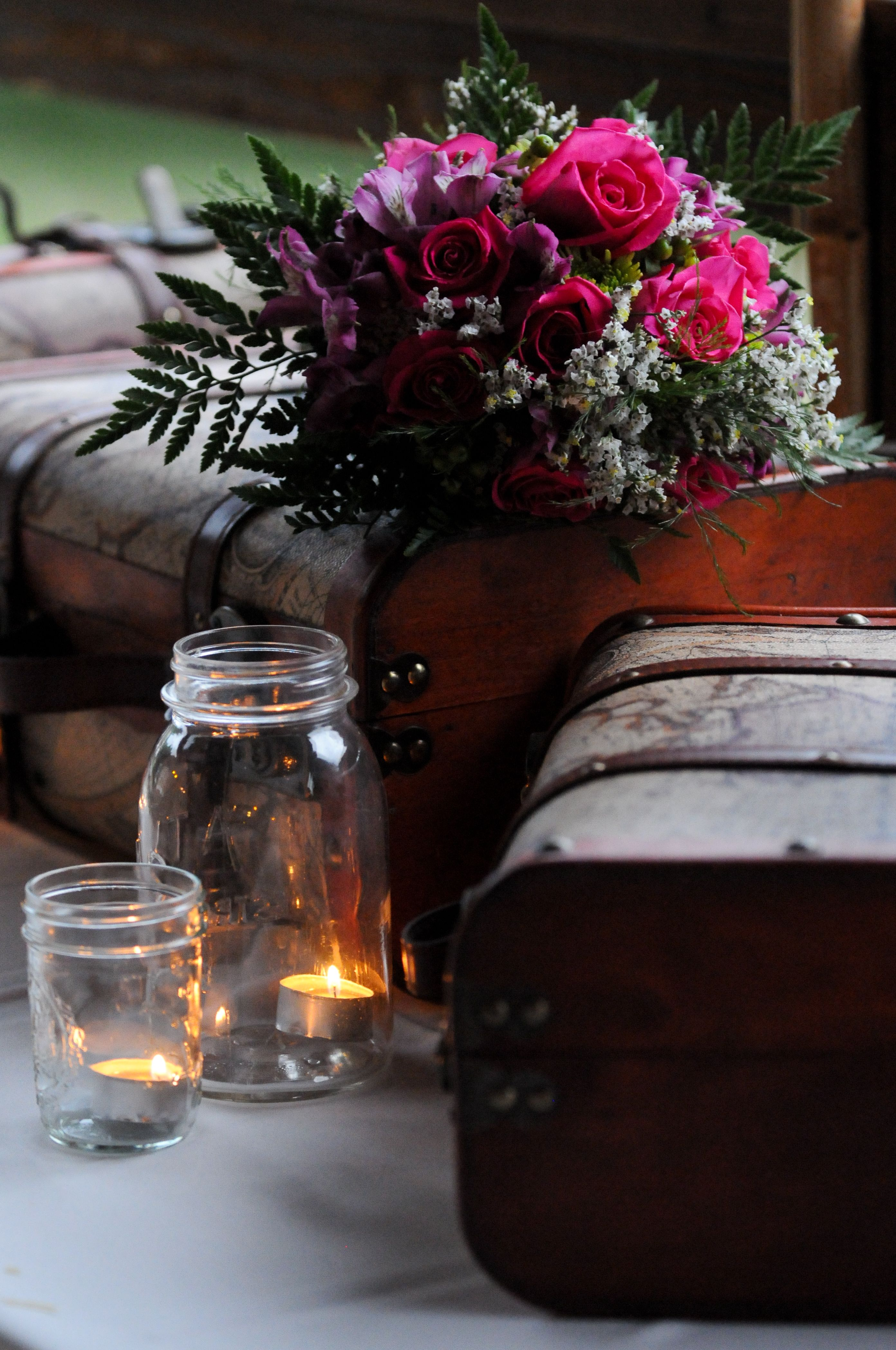 Color mason jars put in sand or something with tea light candles