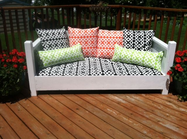 A repurposed twin bed made into an outdoor sofa.  With waterproof mattress and outdoor fabrics.