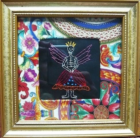 """Felicia, by artist Mavis Leahy, Hand embroidered on linen embellished with Milagros, repurposed frame. 6 ¼"""" x 61/4"""" - SOLD"""