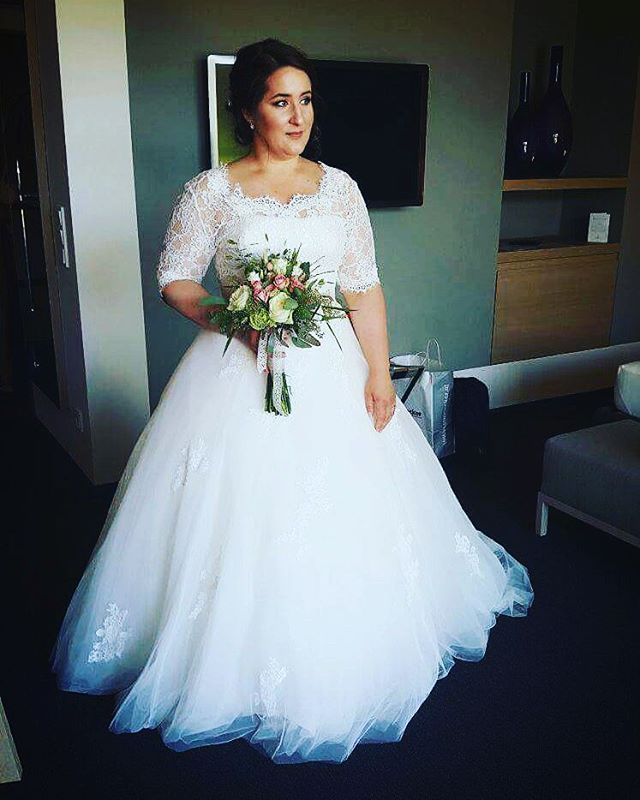 84977706c20 This short sleeve  plussize wedding dress has a pretty lace bodice. Get   weddinggowns like this custom made to order with any design change you  need and in ...