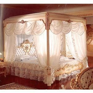 This canopy bed looks fit for a queen!