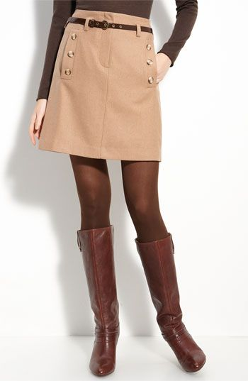 Loving the skirt, brown tights, and boots