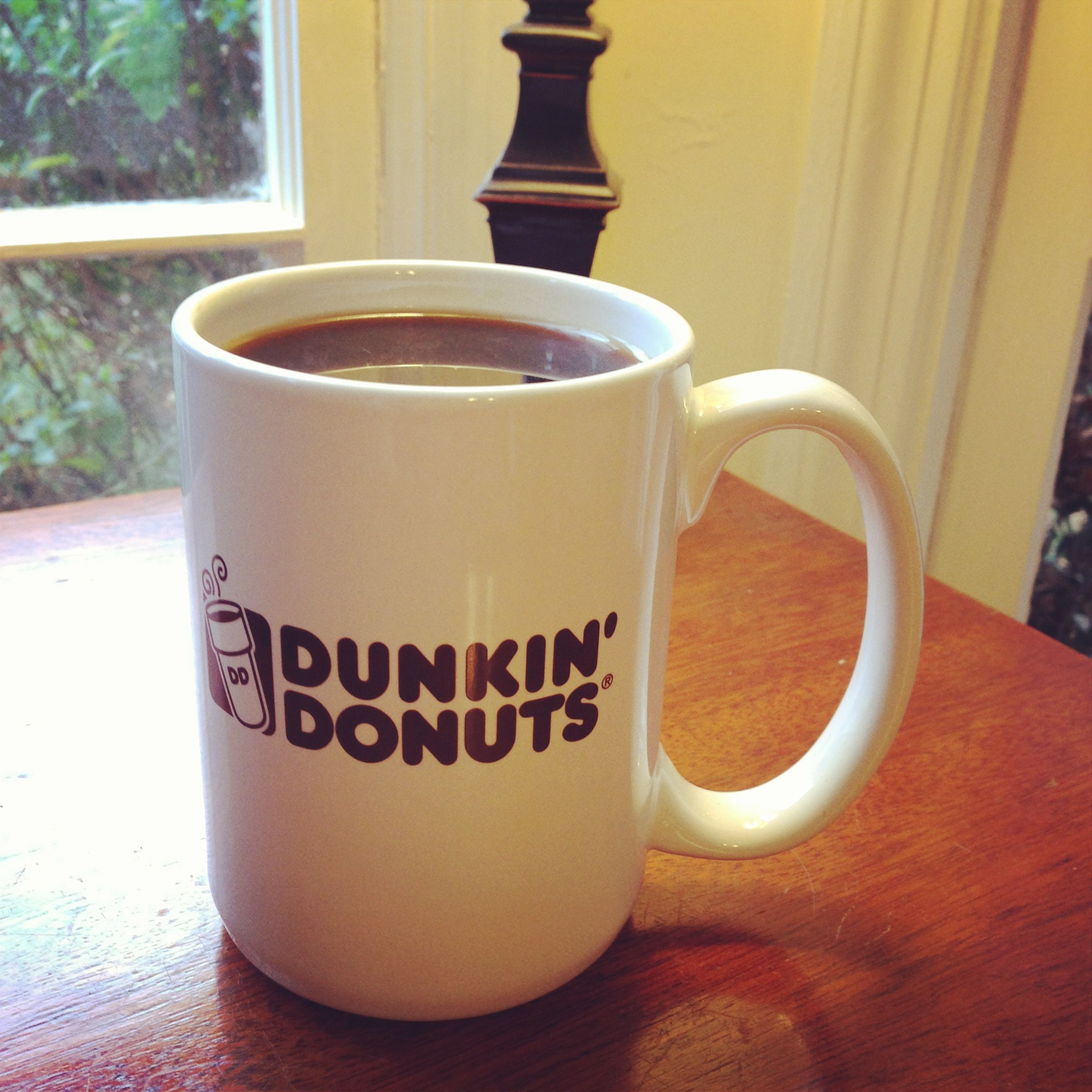 Enjoying a delicious cup of Dunkin' Donuts Coffee to keep