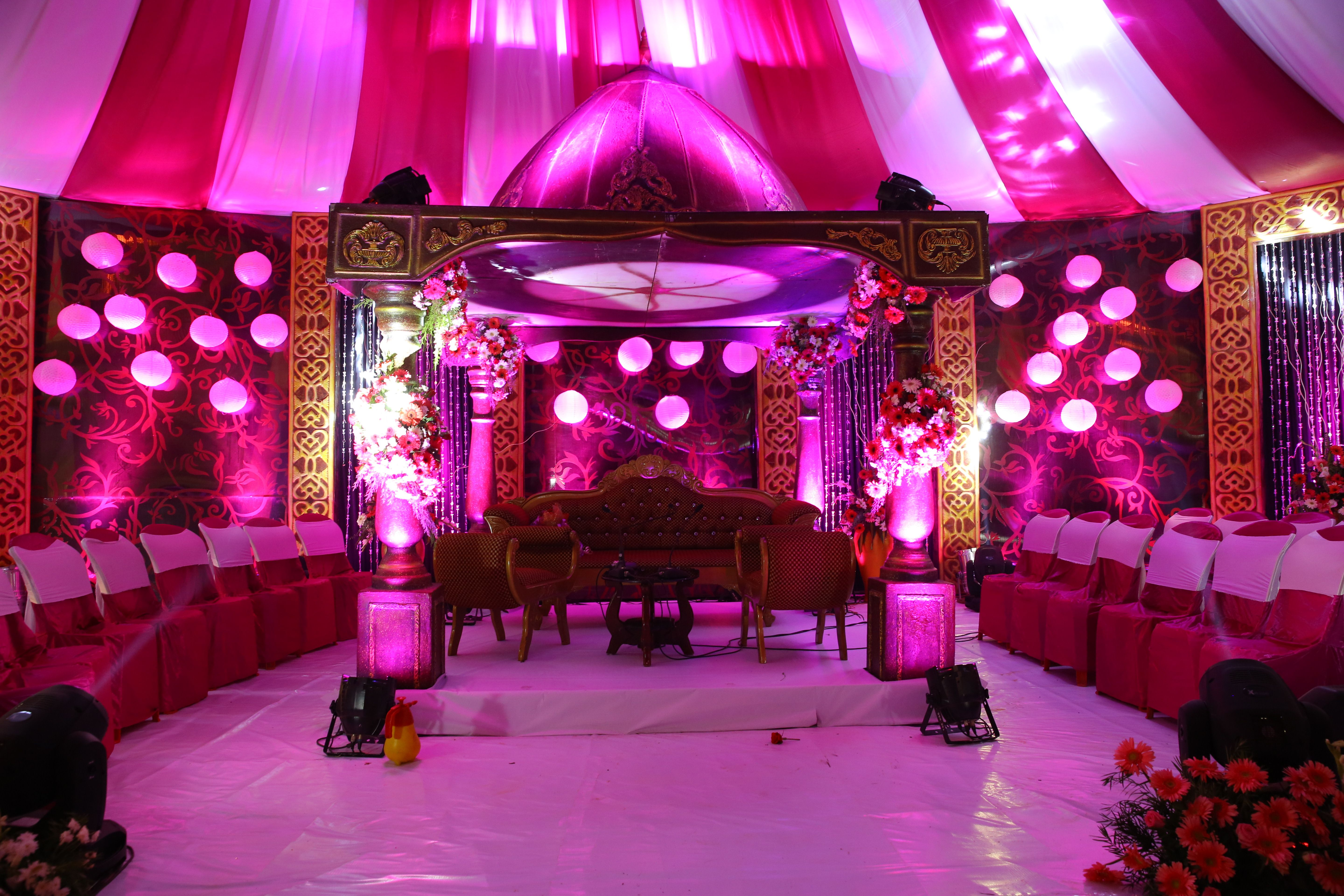 Pink and Purple theme based wedding stage decoration with fresh ...