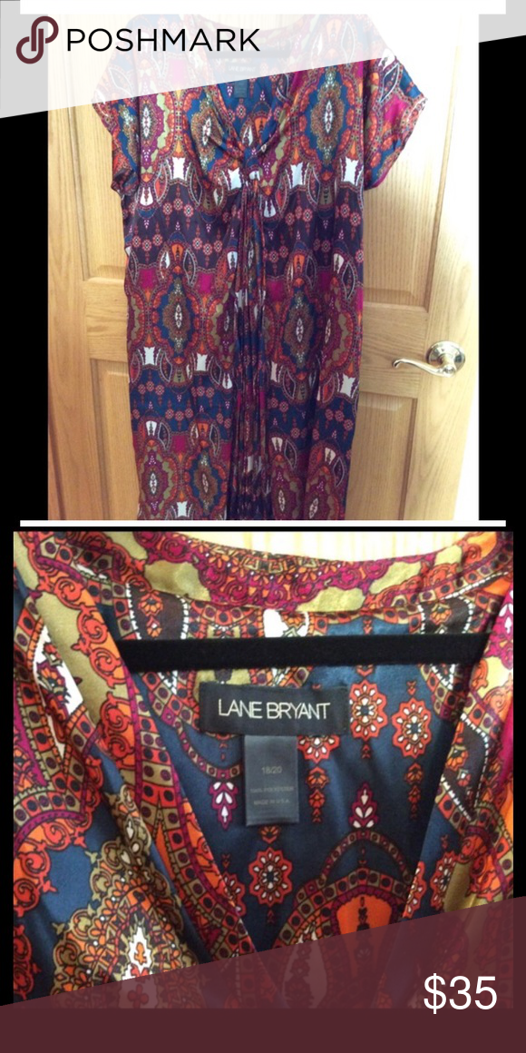 Jewel tone Lane Bryant dress Dress by Lane Bryant in vibrant jewel tones.  V neck, tunic style.  Sleeveless or small cap sleeve.  Silky heavier weight fabric.  Tag marked 18/20 and hits roughly at or slightly below knee.  Great fall/winter work dress.  Easily slips over your head, very comfortable. Lane Bryant Dresses Midi
