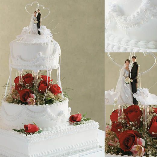 Holly: Romance is the flavor of this three-tiered triumph with its flowing double drapes, brilliant white buttercream icing and starkly dramatic traditional red roses.