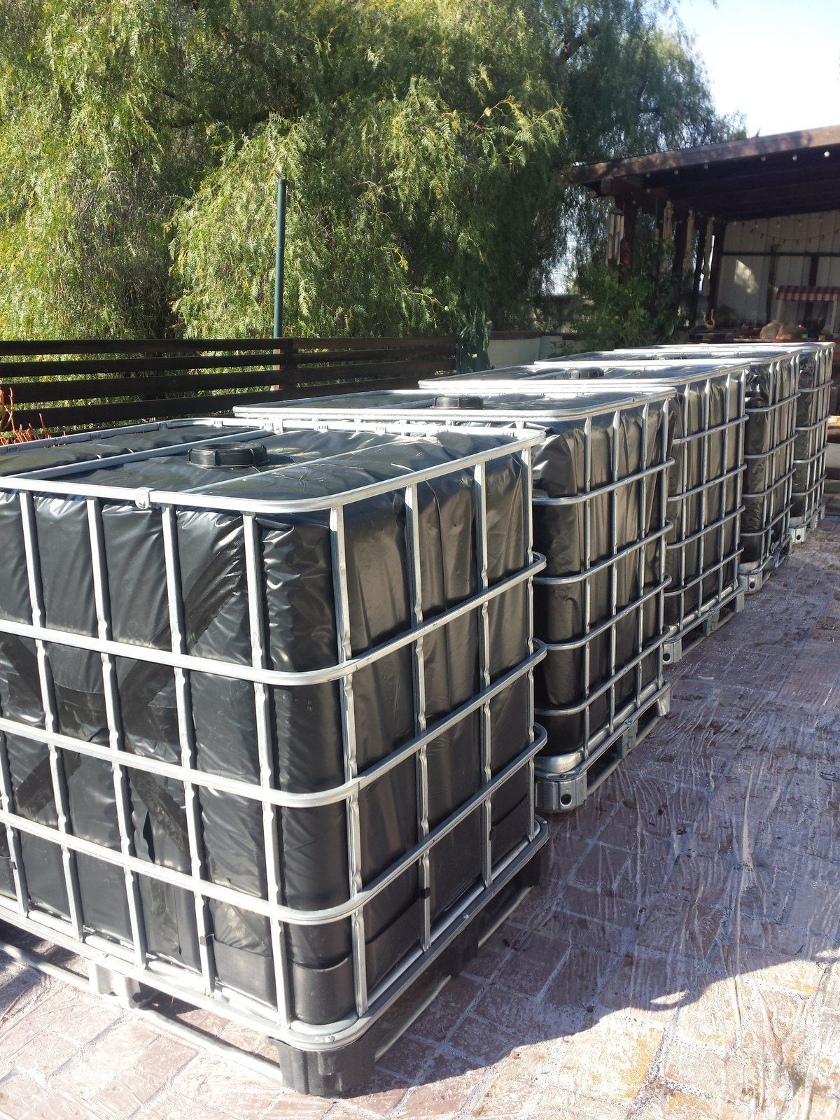 Rainwater Harvesting Ibc Totes Wrapped In 6mm Plastic The Greenman Project Wassertonne Regenwasser Abwasser