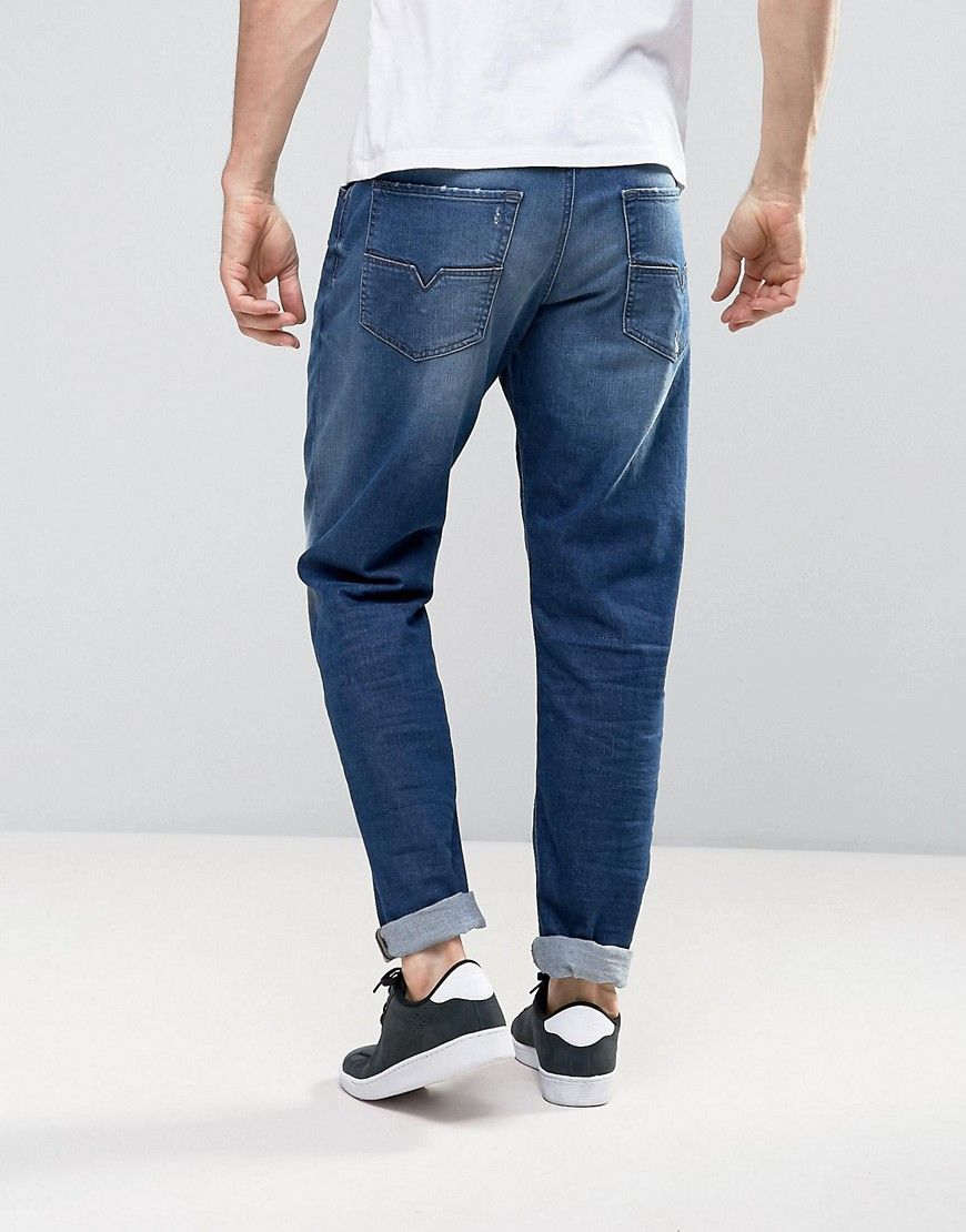 c77ded26 Diesel Larkee-Beex regular tapered fit jeans in 084CV mid wash ...
