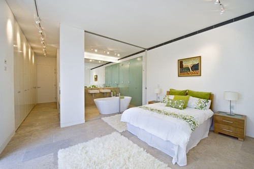 Spacious Bedroom Area With Green And White Pillows Beside Bathtub In White Color At The Design Ideas For Bedrooms simple model,  #small bedroom windows  #bedroom windows ideas