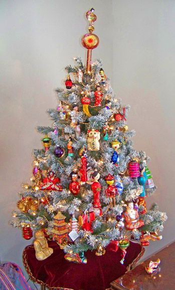 There are so many wonderful Asian themed ornaments nowadays.  Why not try your hand at a small theme tree?  This beauty is from Al S. In NY. courtesy of Celebrate365  Asian Tree 5 ft frosted tree filled with Asian ornaments from a wide variety of makers, including John Toole (finial), Ornaments to Remember...
