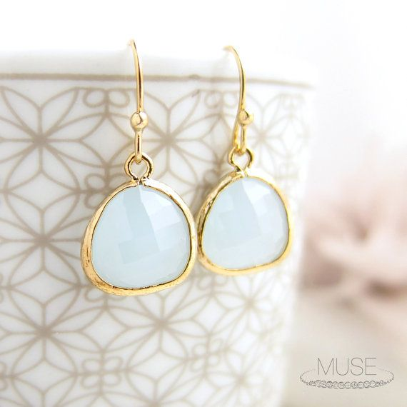 A pair of sparkling alice blue faceted glass is beautifully framed in 16k gold plated textured bezels. Cool and classy, the color of these earrings are
