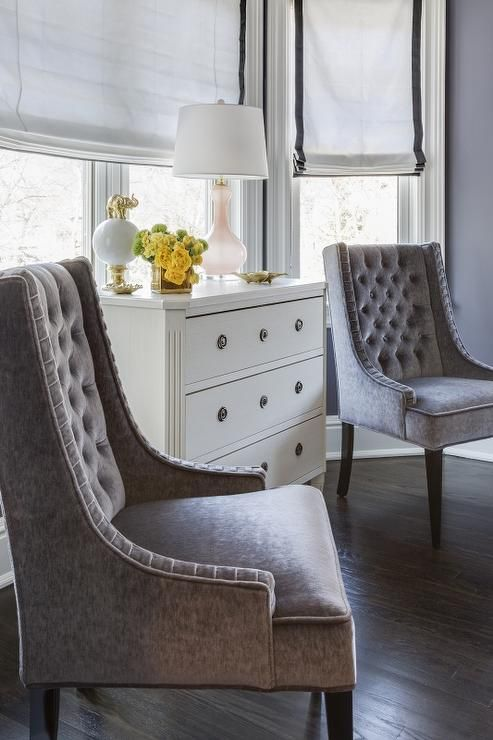 Chic Bedroom Bay Window Is Filled With A White French Chest Topped With A  Delicate Pink Glass Lamp Flanked By Gray Velvet Tufted Chairs Placed Under  Windows ...