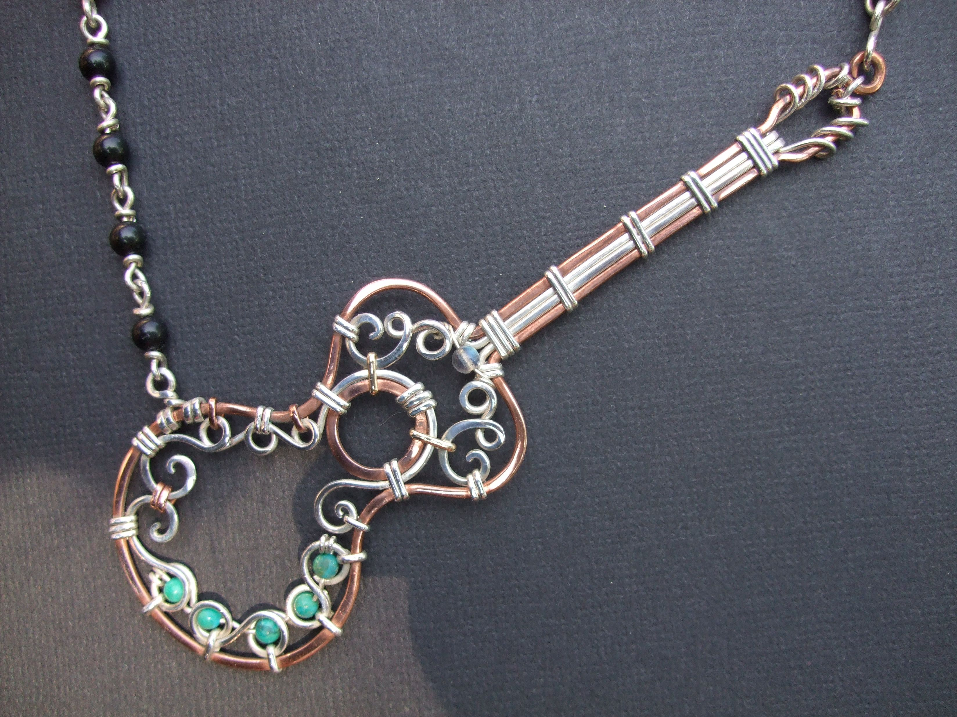 Copper, sterling silver, turquoise, and obsidian guitar necklace I made.  Picture only, no link.