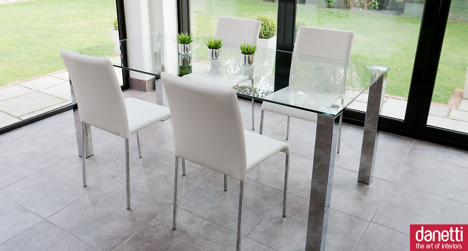 The Tiva Chrome And Glass Dining Table Combines Style And