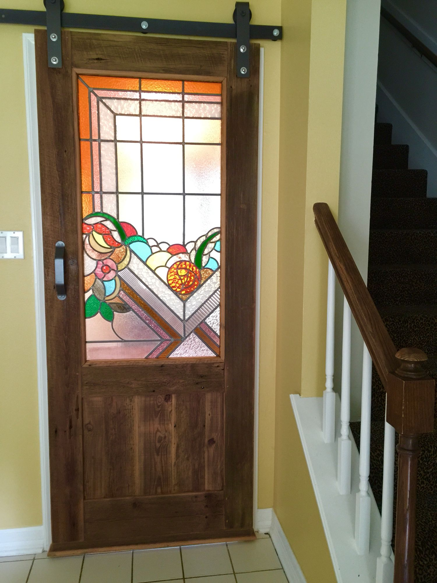 Stained Glass Sliding Door Using Recycled Wood From Restoring Texas