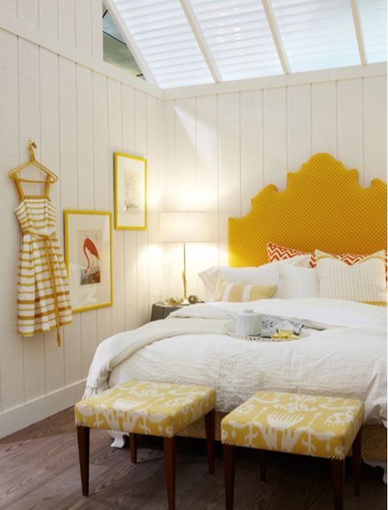 White planked walls, upholstered yellow headboard with white polka dots,  yellow benches. (guest room - with twin beds, lighter color on the  headboards)