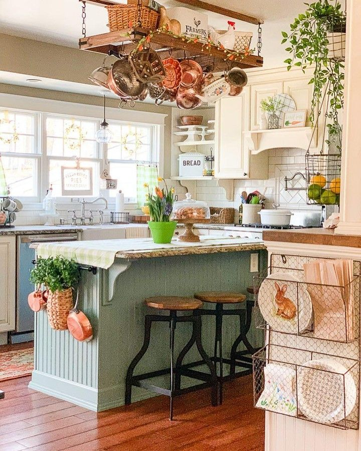 "Photo of The Cottage Journal (@thecottagejournal) posted on Instagram: ""Wire baskets, hanging copper cookware, and that sweet green island… Country cottage charm at its best! (📸: goldenboysandme)"" • Apr 13, 2019 at 2:00pm UTC"