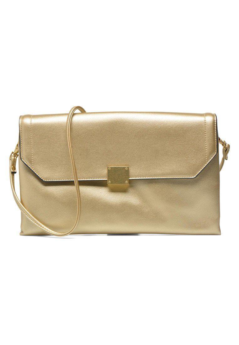 ac4feade8 que es un personal shopper - bolso de mano dorado | Personal Shopper ...
