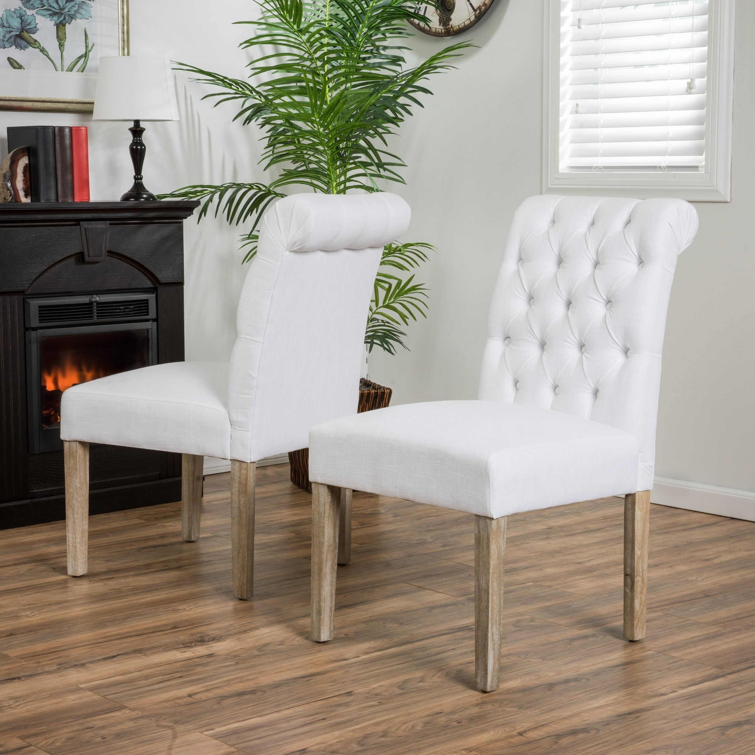 With an elegantly rolled top the dinah white dining chairs are