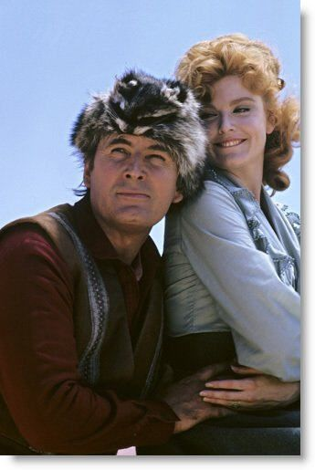Fess Parker, seen here in his famous coonskin cap with co-star Patricia Blair