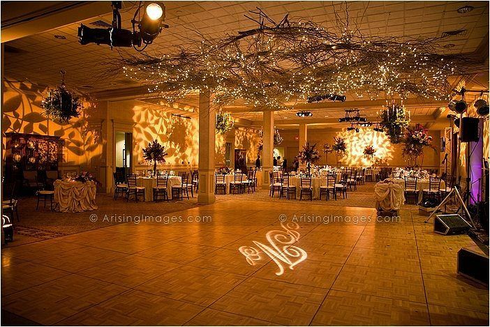 Love this setup with #gobo #monogram on the dancefloor at this #uplighting #wedding  #reception ! Photo via #arisingimages