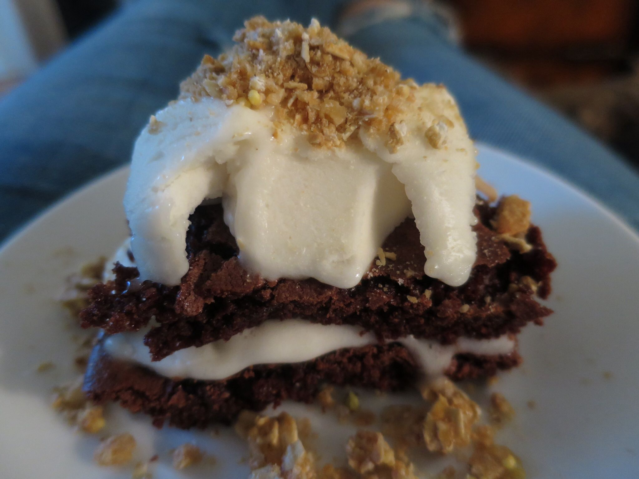 Brownie ice cream sandwich topped with granola!  Classic and simple dessert.