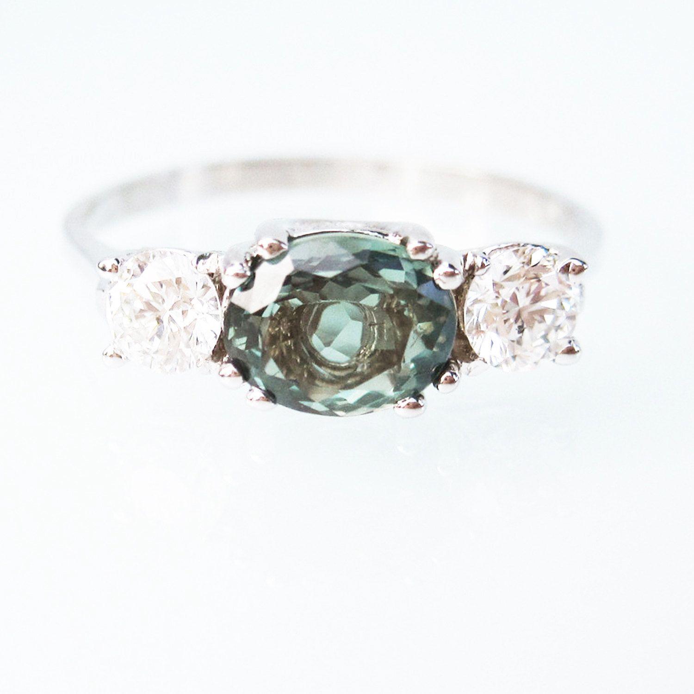 53381ebc69933 Natural Alexandrite Diamond alternative Engagement ring oval horizontal  trinity 18k gold - Custom Made to Order. $4,150.00, via Etsy.