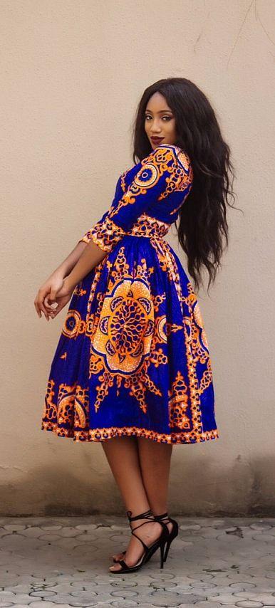 8f44fcf39ea the midi VICTORIA dress. V neck African print midi dress with 3 4 sleeve
