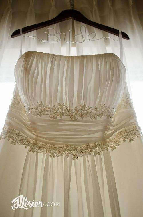 Gorgeous wedding dress details!  Don't forget that Bride hanger for the extra touch!