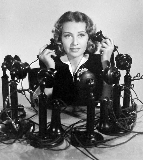 Image result for antique telephone with a woman calling