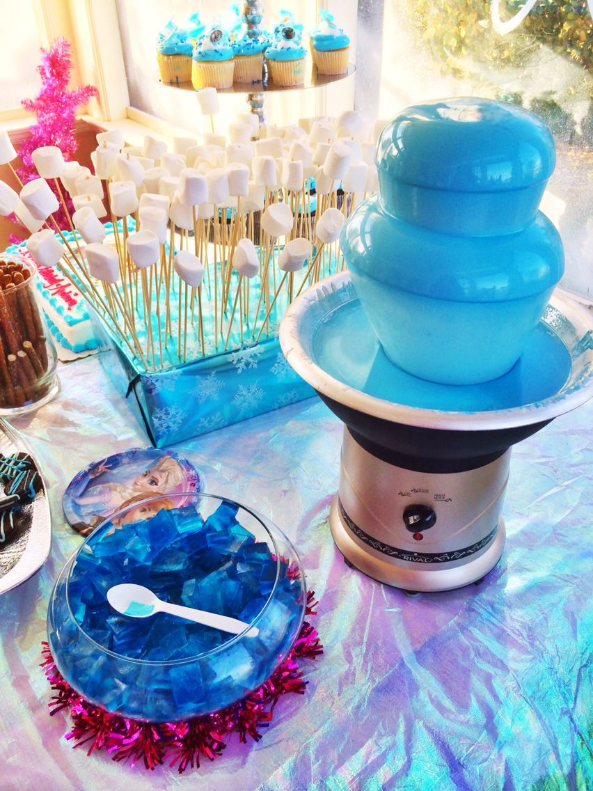 Blue chocolate fountain for Frozen party. White chocolate and blue ...