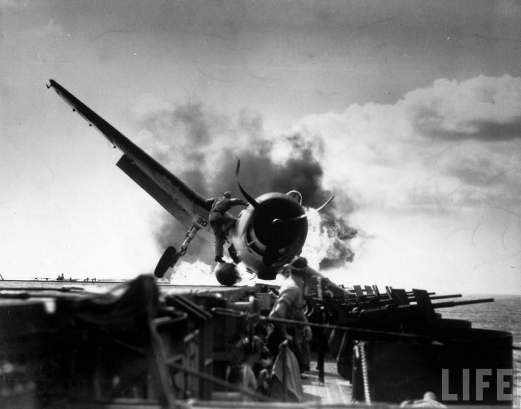 Crash landing of F6F Hellcat on flight deck of USS Enterprise while en route to attack Makin Island, 1943