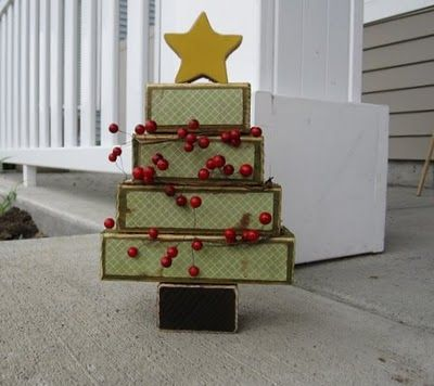 wooden christmas tree, 2x4's cut into different sizes and mod podged with paper.  Could just paint as well