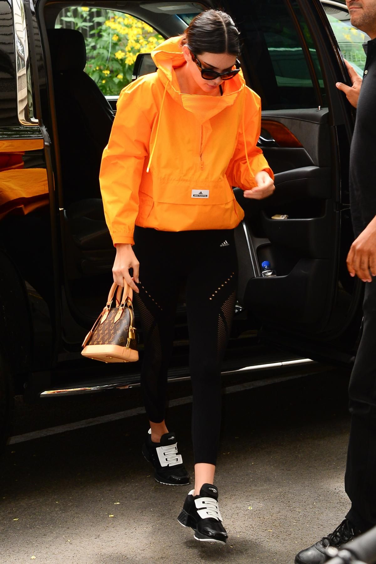 559b4f4ed292 Kendall Jenner wearing Louis Vuitton Monogram Alma Bb Bag, Adidas By Stella  McCartney Hooded Shell Jacket, Adidas Warp Knit Tights and Adidas Clima  Cool ...