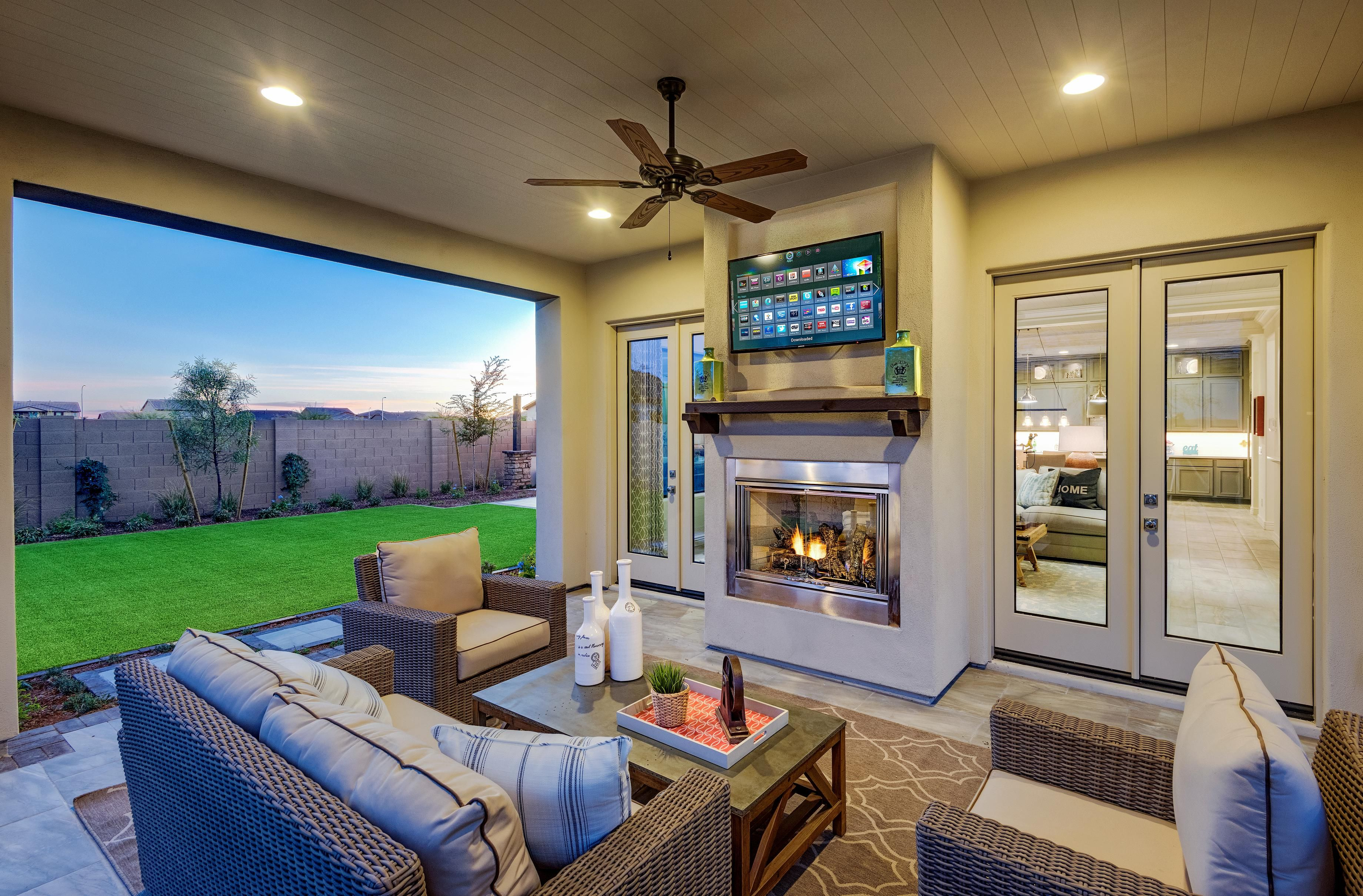 enjoy sitting fireside under your covered patio from toll brothers