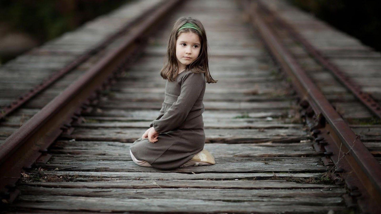 cute girl on the tracks