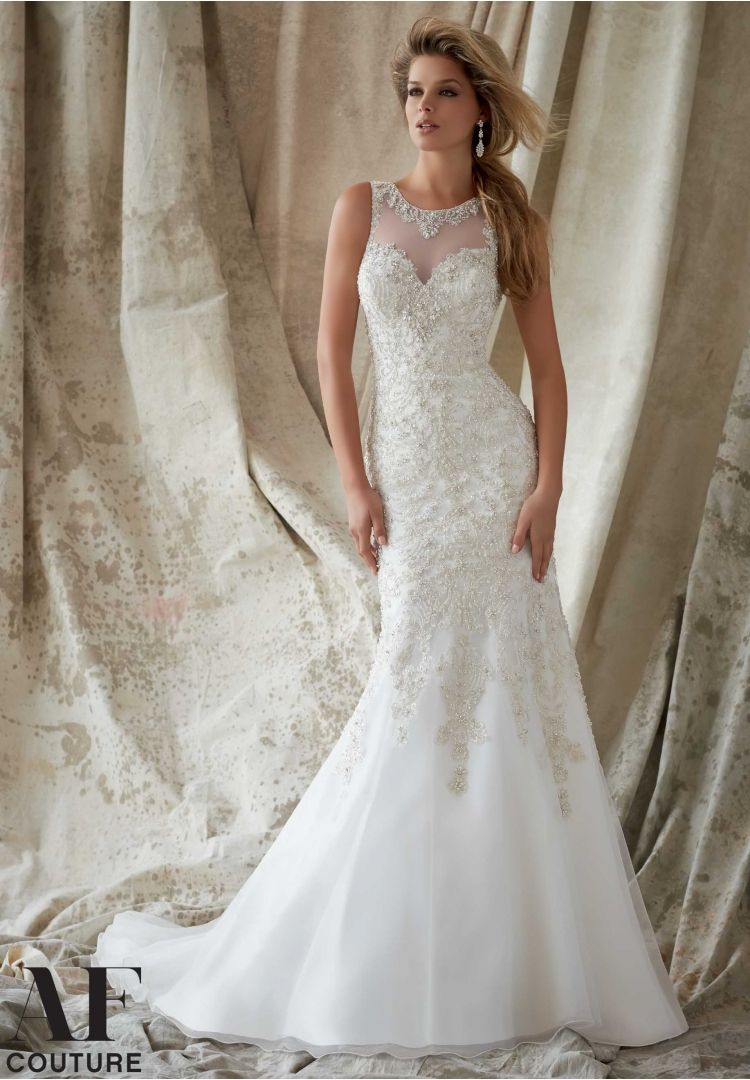 Bridal gowns by af couture featuring intricate embroidery with
